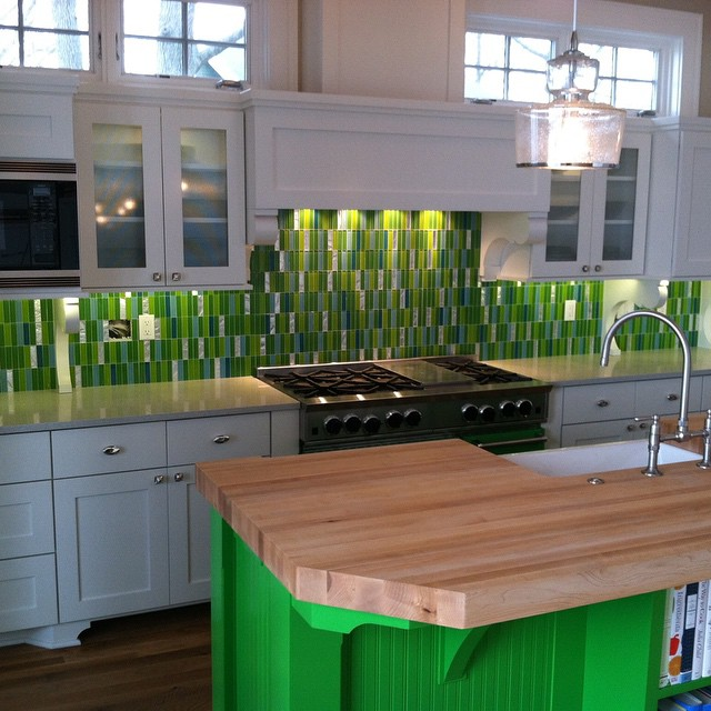 green kitchen renovation wood counter backsplash