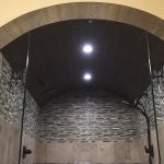 fancy custom shower with arch tile stone