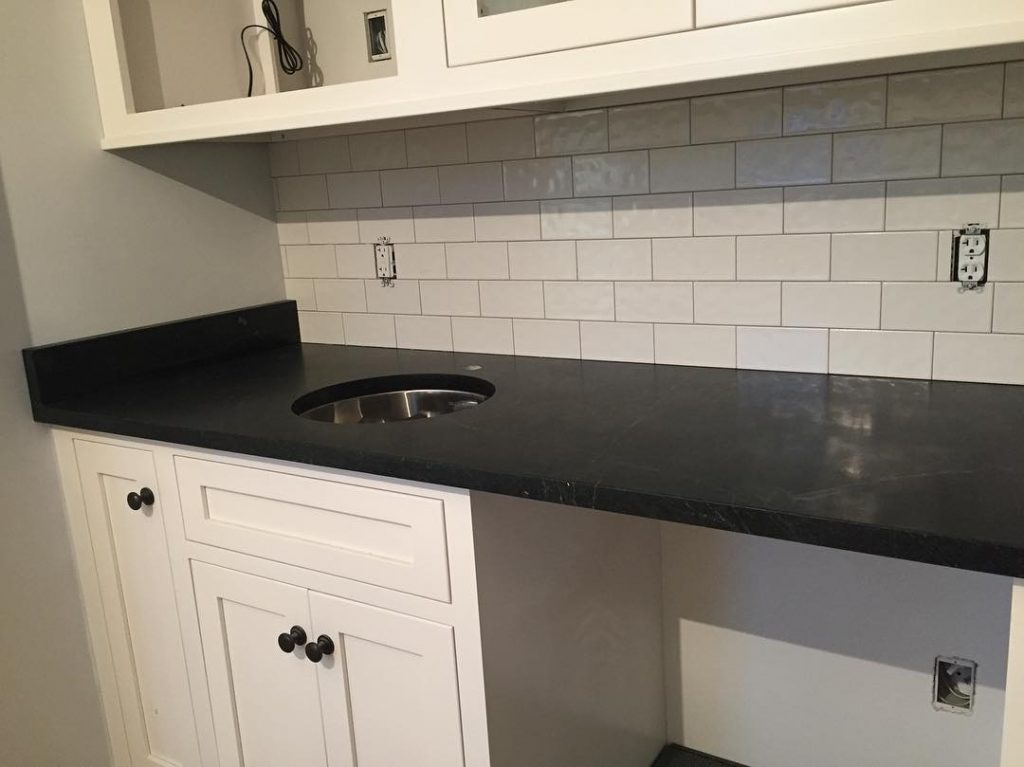 dark counter with white tiles