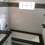 white shower tub custom tile glass dark accent
