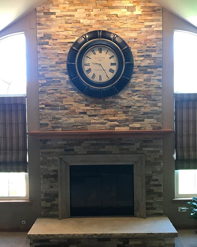 stone fireplace with clock